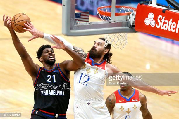 Joel Embiid of the Philadelphia 76ers is fouled by Steven Adams of the New Orleans Pelicans during the first quarter of an NBA game at Smoothie King...