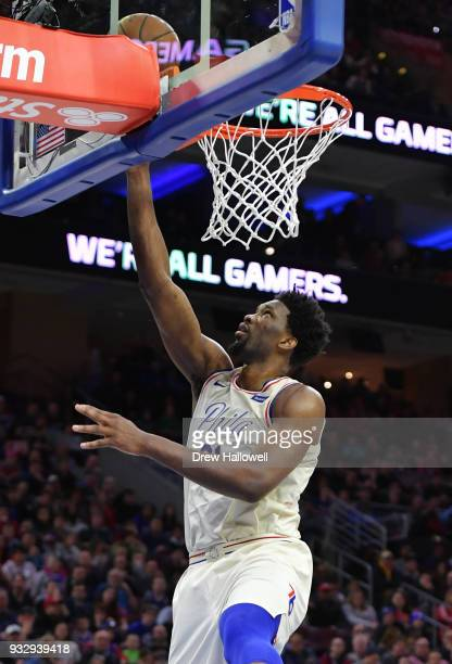 Joel Embiid of the Philadelphia 76ers lays up a shot during the game against the Brooklyn Nets at the Wells Fargo Center on March 16 2018 in...