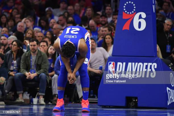 Joel Embiid of the Philadelphia 76ers looks down during a break in the game against the Brooklyn Nets in the second half during Game One of the first...