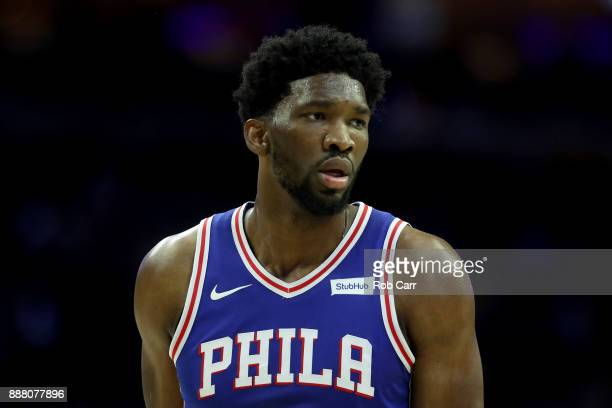 Joel Embiid of the Philadelphia 76ers looks on against the Los Angeles Lakers at Wells Fargo Center on December 7 2017 in Philadelphia Pennsylvania...