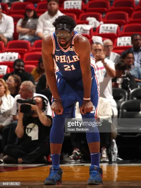 Joel Embiid of the Philadelphia 76ers looks on against the Miami Heat in Game Three of Round One of the 2018 NBA Playoffs on April 19 2018 at...