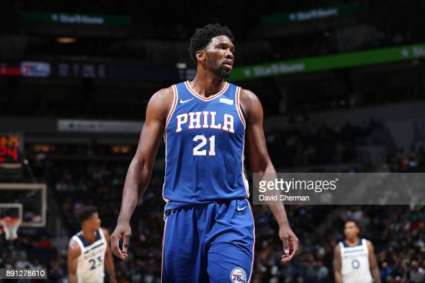 Joel Embiid of the Philadelphia 76ers looks on during the game against the Minnesota Timberwolves on December 12 2017 at Target Center in Minneapolis...
