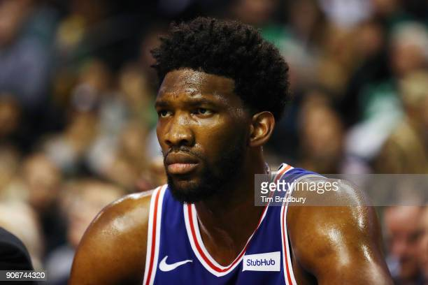 Joel Embiid of the Philadelphia 76ers looks on from the bench during the first half against the Boston Celtics at TD Garden on January 18 2018 in...