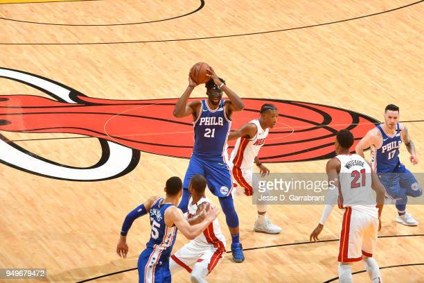 Joel Embiid of the Philadelphia 76ers looks to pass against the Miami Heat in Game Four of Round One of the 2018 NBA Playoffs on April 21 2018 at...