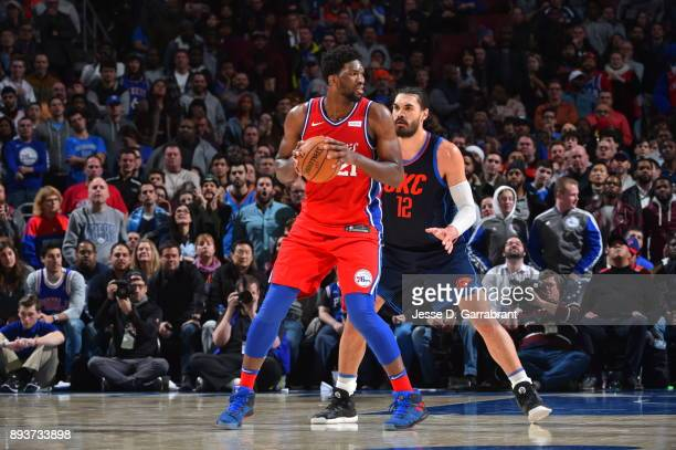Joel Embiid of the Philadelphia 76ers looks to pass the ball against the Oklahoma City Thunder at Wells Fargo Center on December 15 2017 in...