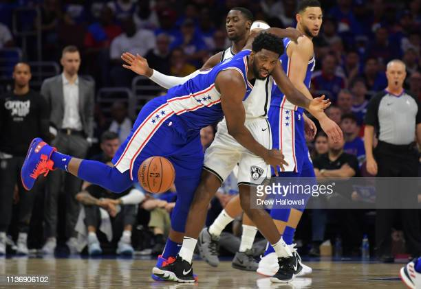 Joel Embiid of the Philadelphia 76ers loses the ball as Caris LeVert of the Brooklyn Nets defends in the first half during Game One of the first...
