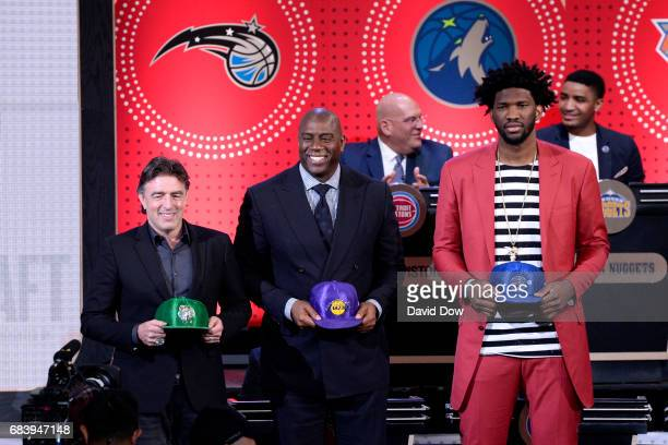 Joel Embiid of the Philadelphia 76ers Magic Johnson of the Los Angeles Lakers and Wycliffe Grousbeck of the Boston Celtics look on during the 2017...