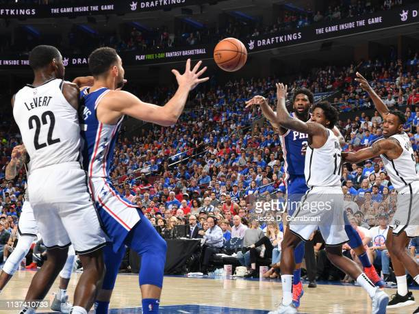 Joel Embiid of the Philadelphia 76ers passes the ball to Ben Simmons of the Philadelphia 76ers against the Brooklyn Nets during Game One of Round One...
