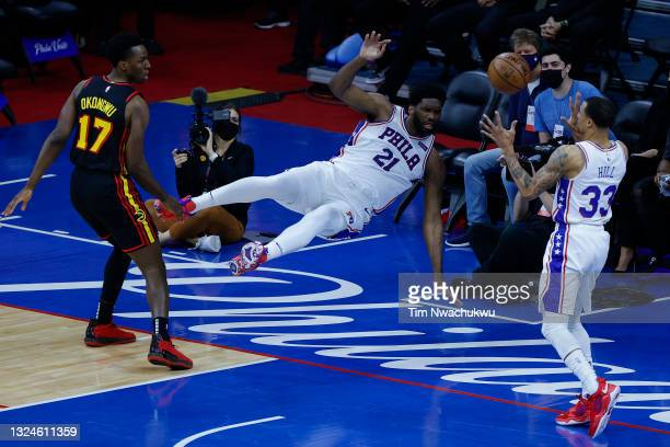 Joel Embiid of the Philadelphia 76ers passes to George Hill during the first quarter against the Atlanta Hawks during Game Seven of the Eastern...