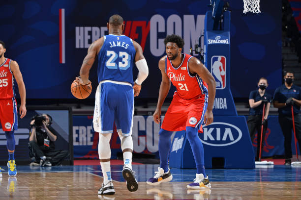 Joel Embiid of the Philadelphia 76ers plays defense against LeBron James of the Los Angeles Lakers on January 27, 2021 at Wells Fargo Center in...
