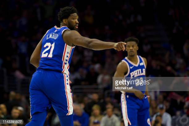 Joel Embiid of the Philadelphia 76ers points as Jimmy Butler looks on against the Brooklyn Nets in Game Two of Round One of the 2019 NBA Playoffs at...