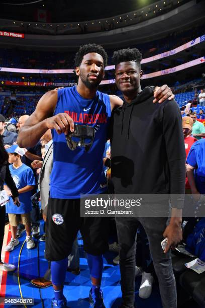 Joel Embiid of the Philadelphia 76ers poses for a photo with Mohamed Bamba prior to game one of round one of the 2018 NBA Playoffs against the Miami...