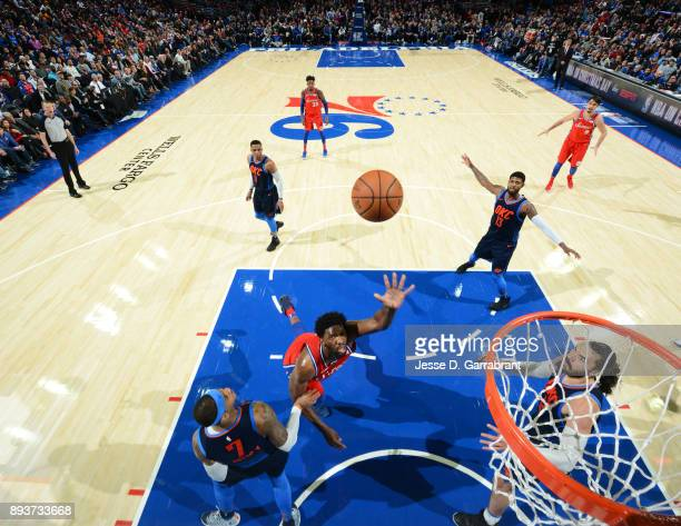 Joel Embiid of the Philadelphia 76ers puts up the shot against the Oklahoma City Thunder at Wells Fargo Center on December 15 2017 in Philadelphia...
