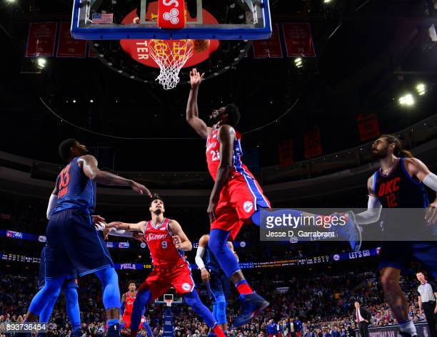 Joel Embiid of the Philadelphia 76ers puts up the shot against the Oklahoma City Thunder at Wells Fargo Center on December 15 2017 in Philadelphia...