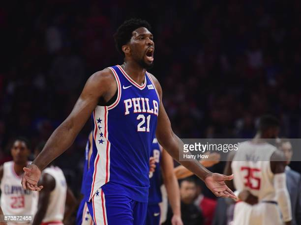 Joel Embiid of the Philadelphia 76ers reacts after a foul from Willie Reed of the LA Clippers during the first half at Staples Center on November 13...