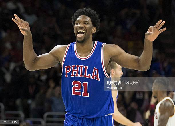 Joel Embiid of the Philadelphia 76ers reacts after a made basket against the Cleveland Cavaliers in the third quarter at Wells Fargo Center on...