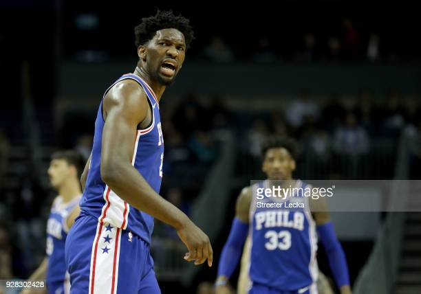Joel Embiid of the Philadelphia 76ers reacts after a play against the Charlotte Hornets during their game at Spectrum Center on March 6 2018 in...