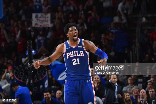 Joel Embiid of the Philadelphia 76ers reacts after a play against the Indiana Pacers at the Wells Fargo Center on March 13 2018 in Philadelphia...