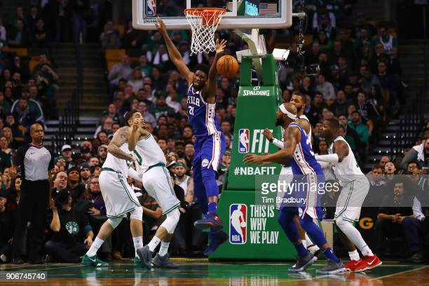 Joel Embiid of the Philadelphia 76ers reacts after being fouled during the first half against the Boston Celtics at TD Garden on January 18 2018 in...
