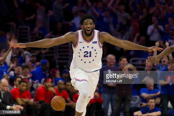 Joel Embiid of the Philadelphia 76ers reacts after dunking the ball against the Toronto Raptors in the fourth quarter of Game Three of the Eastern...
