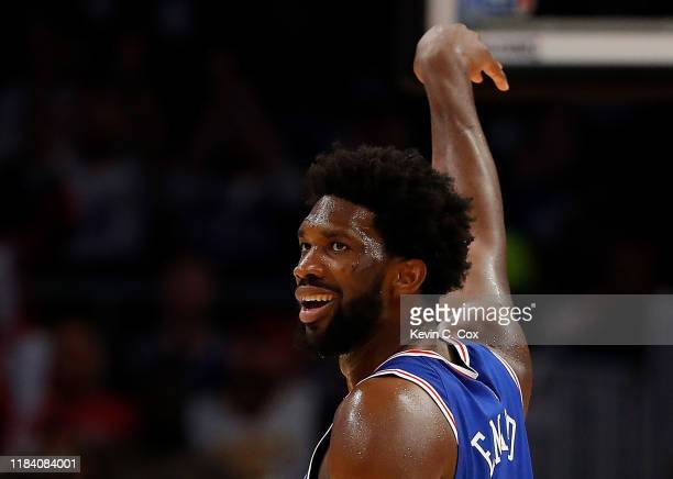 Joel Embiid of the Philadelphia 76ers reacts after hitting a threepoint basket against the Atlanta Hawks in the second half at State Farm Arena on...
