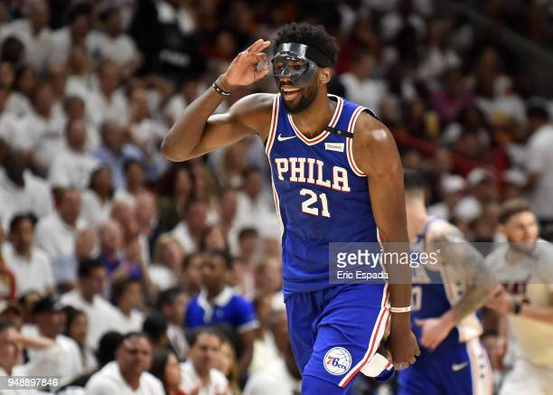 Joel Embiid of the Philadelphia 76ers reacts after hitting a three pointer in the third quarter against the Miami Heat at American Airlines Arena on...