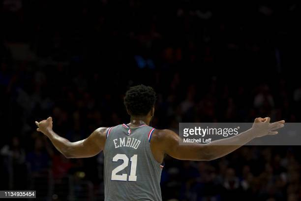Joel Embiid of the Philadelphia 76ers reacts after making a three point basket against the Milwaukee Bucks in the second quarter at the Wells Fargo...