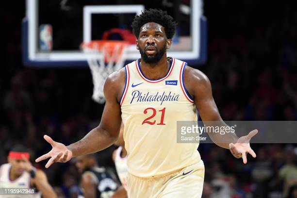 Joel Embiid of the Philadelphia 76ers reacts after scoring during the first half of the game against the Milwaukee Bucks at Wells Fargo Center on...