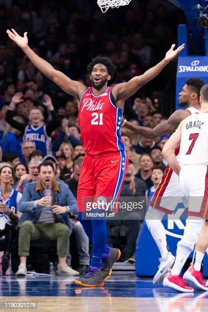 Joel Embiid of the Philadelphia 76ers reacts against the Miami Heat at the Wells Fargo Center on November 23, 2019 in Philadelphia, Pennsylvania. The...