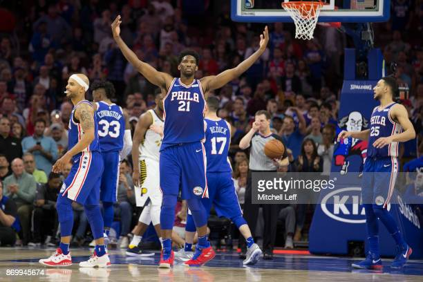 Joel Embiid of the Philadelphia 76ers reacts along with Jerryd Bayless Robert Covington JJ Redick and Ben Simmons after a made foul shot in the...