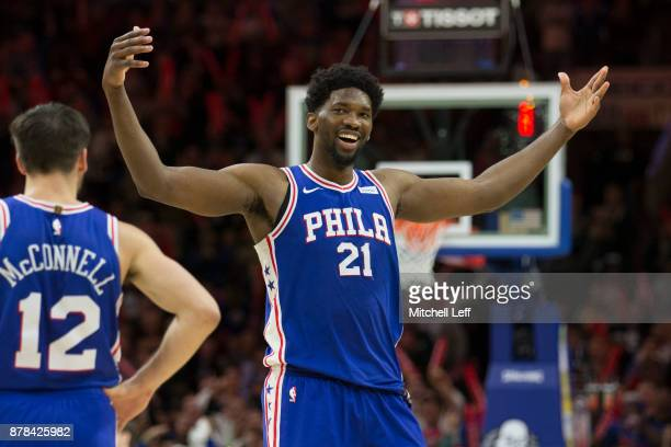 Joel Embiid of the Philadelphia 76ers reacts along with TJ McConnell after drawing a technical foul on Donovan Mitchell of the Utah Jazz in the...