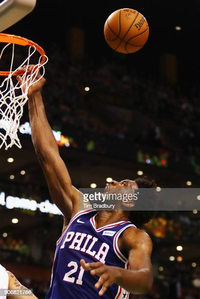 Joel Embiid of the Philadelphia 76ers reacts as he is fouled during the second half against the Boston Celtics at TD Garden on January 18 2018 in...