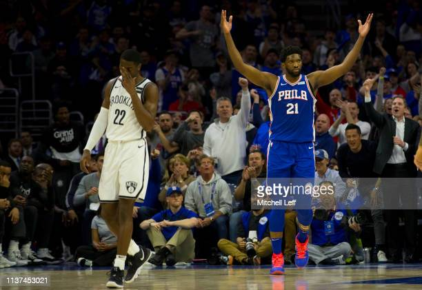 Joel Embiid of the Philadelphia 76ers reacts in front of Caris LeVert of the Brooklyn Nets in the second quarter of Game Two of Round One of the 2019...