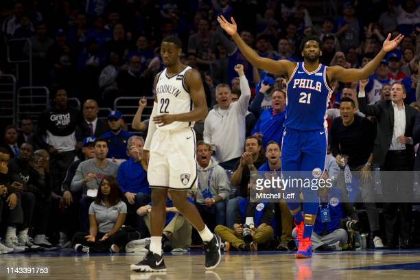 Joel Embiid of the Philadelphia 76ers reacts in front of Caris LeVert of the Brooklyn Nets in Game Two of Round One of the 2019 NBA Playoffs at the...