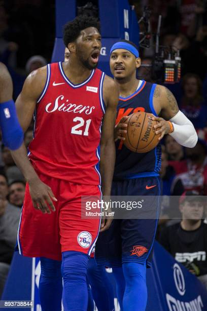 Joel Embiid of the Philadelphia 76ers reacts in front of Carmelo Anthony of the Oklahoma City Thunder in the fourth quarter at the Wells Fargo Center...