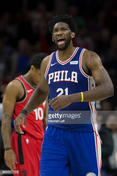Joel Embiid of the Philadelphia 76ers reacts in front of DeMar DeRozan of the Toronto Raptors in the fourth quarter at the Wells Fargo Center on...