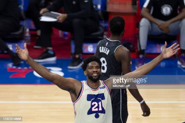 Joel Embiid of the Philadelphia 76ers reacts in front of Jeff Green of the Brooklyn Nets after making a basket and getting fouled in the third...