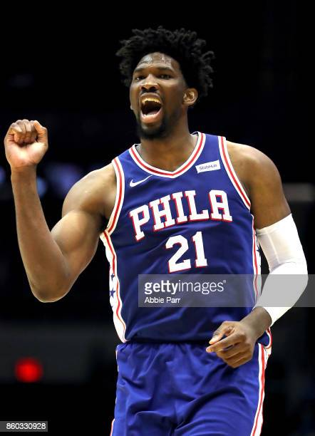 Joel Embiid of the Philadelphia 76ers reacts to a call during the second quarter against the Brooklyn Nets during their Pre Season game at Nassau...