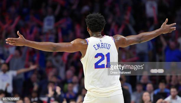 Joel Embiid of the Philadelphia 76ers reacts to the crowd during the game against the Brooklyn Nets at the Wells Fargo Center on March 16 2018 in...