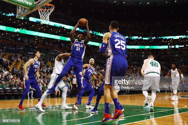 Joel Embiid of the Philadelphia 76ers rebounds the ball during the first half against the Boston Celtics at TD Garden on January 18 2018 in Boston...