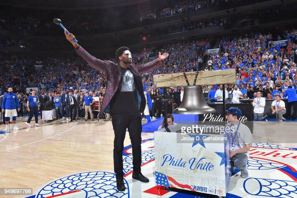 Joel Embiid of the Philadelphia 76ers rings the bell to start the game against the Miami Heat in game one of round one of the 2018 NBA Playoffs on...
