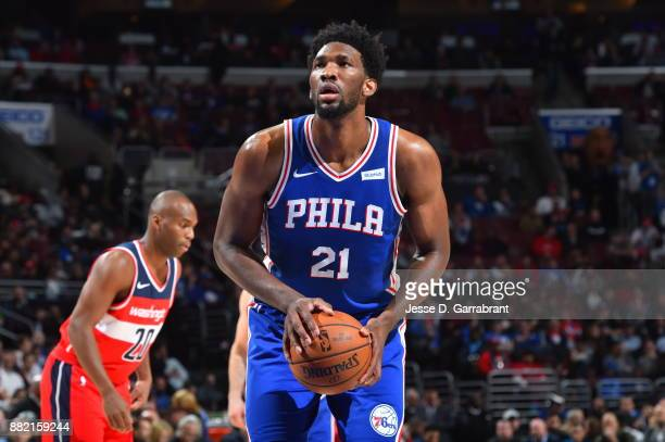 Joel Embiid of the Philadelphia 76ers shoots a foul shot against the Washington Wizards at Wells Fargo Center on November 29 2017 in Philadelphia...