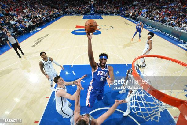 Joel Embiid of the Philadelphia 76ers shoots the ball against against the Brooklyn Nets on March 28 2019 at the Wells Fargo Center in Philadelphia...