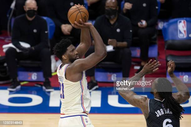 Joel Embiid of the Philadelphia 76ers shoots the ball against DeAndre Jordan of the Brooklyn Nets in the third quarter at the Wells Fargo Center on...