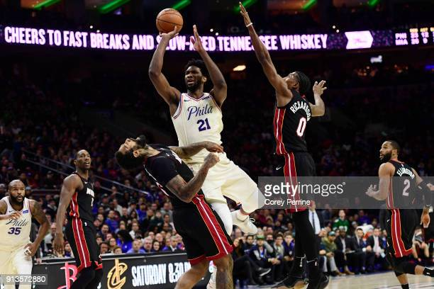 Joel Embiid of the Philadelphia 76ers shoots the ball against James Johnson and Josh Richardson of the Miami Heat during the second quarter at the...