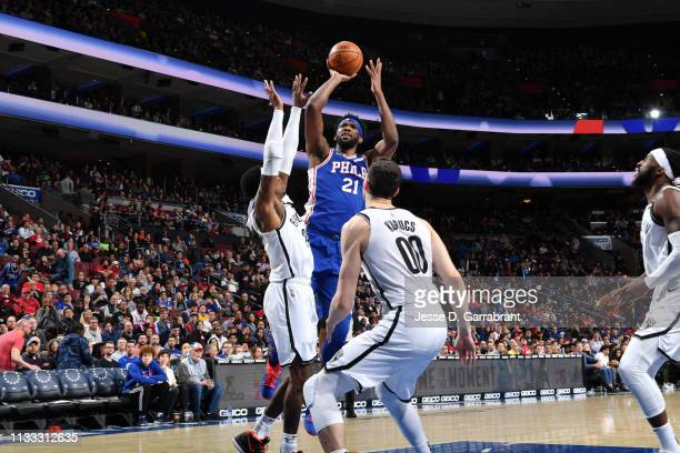 Joel Embiid of the Philadelphia 76ers shoots the ball against the Brooklyn Nets on March 28 2019 at the Wells Fargo Center in Philadelphia...