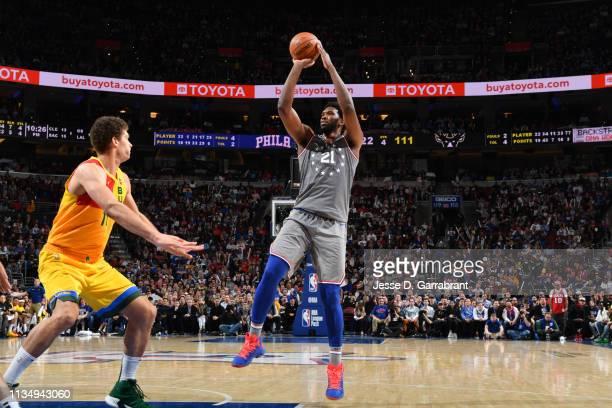 Joel Embiid of the Philadelphia 76ers shoots the ball against the Milwaukee Bucks on April 4, 2019 at the Wells Fargo Center in Philadelphia,...