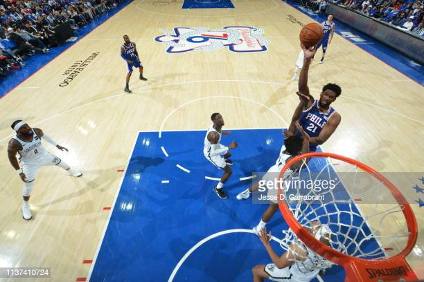 Joel Embiid of the Philadelphia 76ers shoots the ball against the Brooklyn Nets during Game One of Round One of the 2019 NBA Playoffs on April 13...