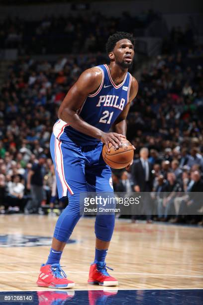 Joel Embiid of the Philadelphia 76ers shoots the ball against the Minnesota Timberwolves on December 12 2017 at Target Center in Minneapolis...
