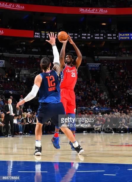 Joel Embiid of the Philadelphia 76ers shoots the ball against the Oklahoma City Thunder at Wells Fargo Center on December 15 2017 in Philadelphia...
